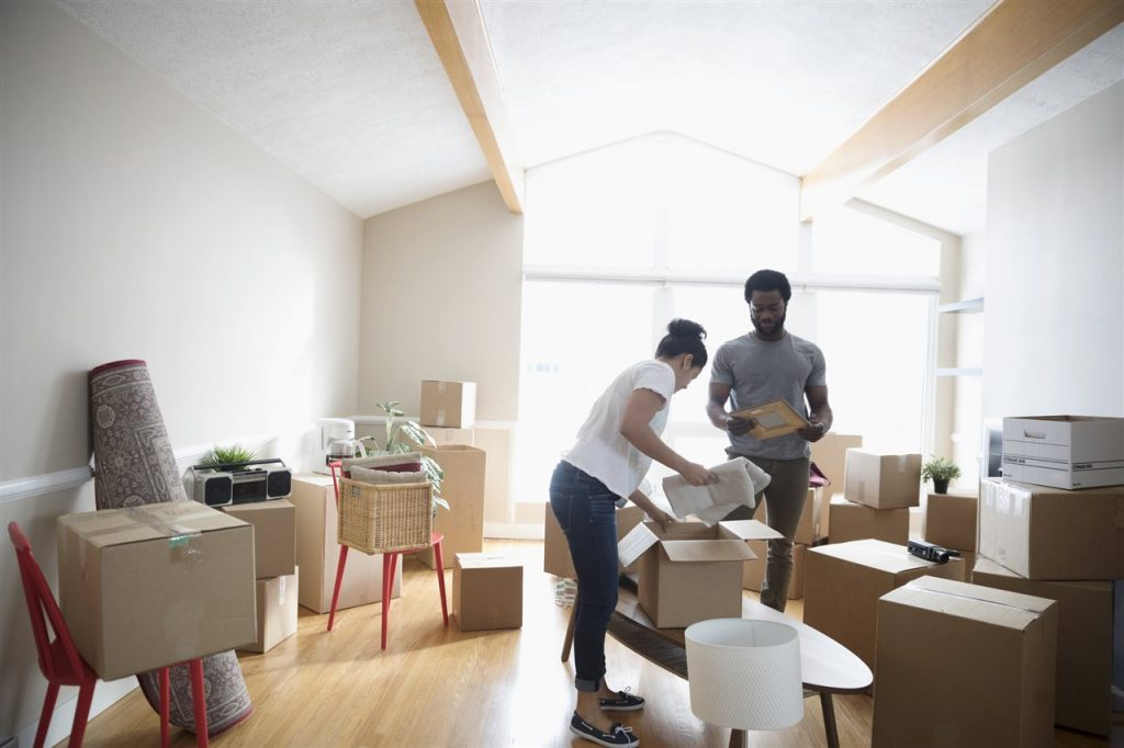 a couple putting things in a box | GC Home Inspection | Preventing Pests Pearland