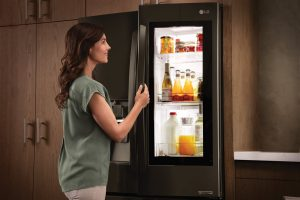 a woman opening a fridge | GC Home Inspection | Kitchen Pearland