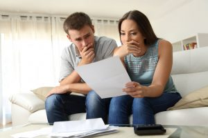 a couple thinking and holding a paper | GC Home Inspection | Insurance Pearland