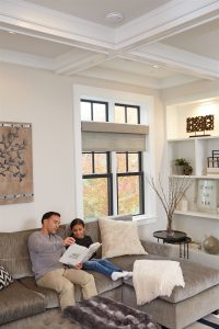 father and daughter reading book in living room | GC Home Inspection | carbon monoxide Pearland