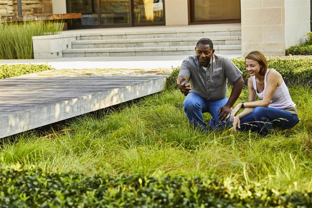 landscape contractor and homeowner in the lawn | GC Home Inspection| landscape professional Pearland