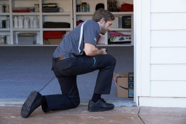 delivery man in garage | GC Home Inspection | smart garage Home Inspection Pearland