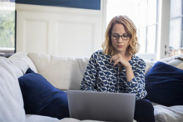 woman looking at her laptop | GC Home Inspection | Pearland Home Inspection | protecting your digital house from cybercrime